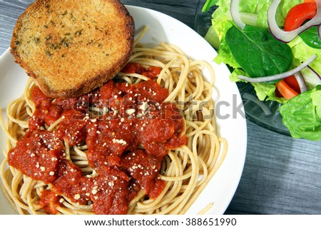 Italian Spaghetti Garlic Toast And Garden Salad Dinner Table Setting Closeup