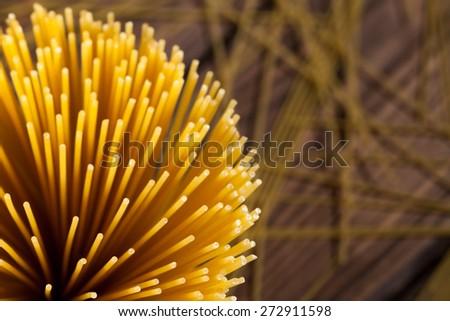italian spaghetti on wooden background. Top view - stock photo