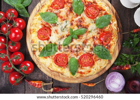 Italian spaghetti pizza margherita with cheese, tomato and basil