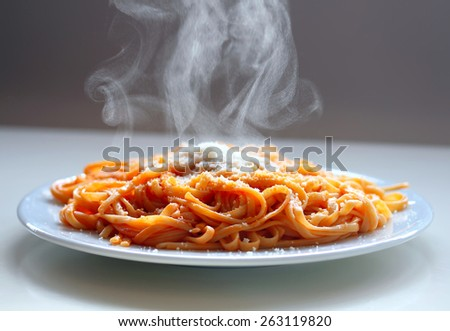 Italian spaghetti steaming with parmesan cheese. - stock photo