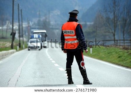 "Italian special military police force ""carabinieri"" stopping traffic car after a collision or car crash. View from behind. - stock photo"
