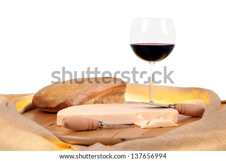 Italian spicy provolone cheese with red wine and bread on white background
