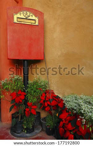 Italian style mailbox with flower - stock photo