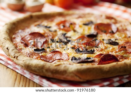 italian style pepperoni pizza with mushrooms - stock photo