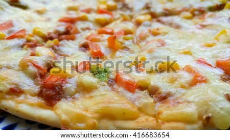 Italian style pizza and corn grain, beef, peppers and tomatoes. Close-up Pizza, blur background, selective focus , soft focus