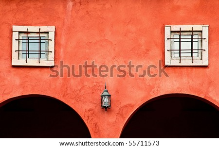 Italian style wall with lamp and window