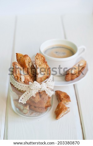 Italian sweets cantuccini with cup of coffee  - stock photo