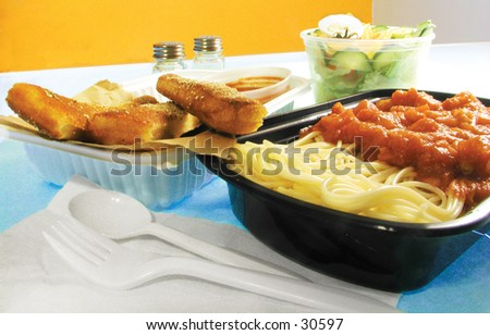 Italian take-out tray. spaghetti, bread stick, salads - stock photo