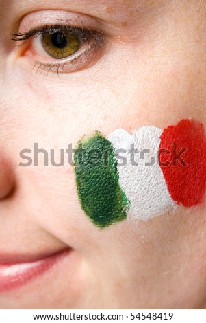 italian team supporter with flag painted on her cheek, studio shoot isolated on black background