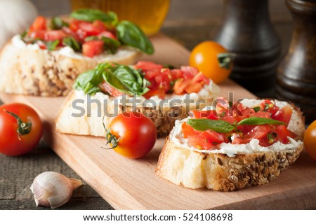 Italian tomato and cheese bruschetta. Tapas, antipasti with chopped ...