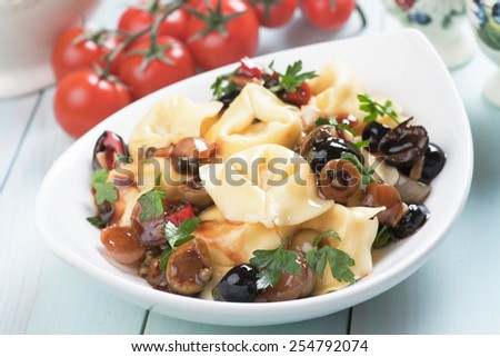 Italian tortellini pasta with parsley and green olives
