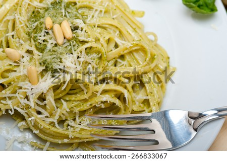 Italian traditional basil pesto pasta ingredients parmesan cheese pine nuts extra virgin olive oil garlic on a rustic table