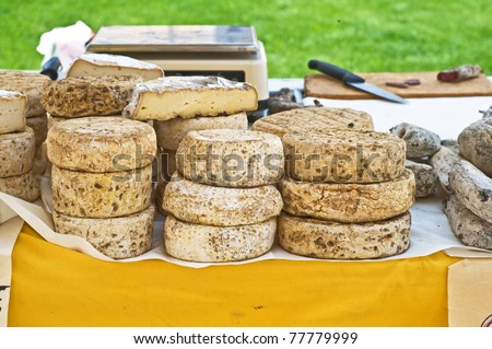 Italian traditional cheese on display at farmer's market - stock photo