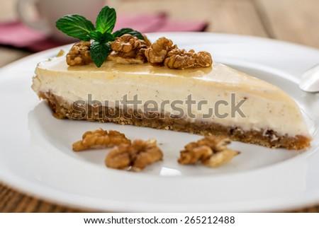 Italian traditional dessert cheesecake of ricotta with walnuts - stock photo
