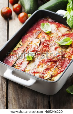 Italian traditional parmigiana with zucchini, selective focus