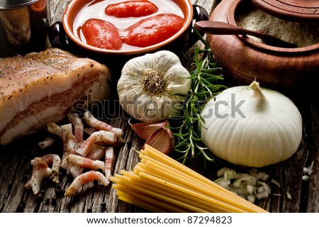 italian traditional pasta amatriciana ingredients on wood - stock photo