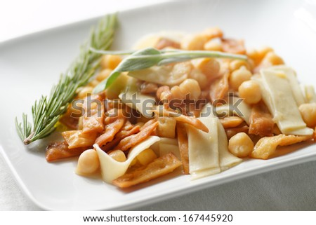 Italian traditional pasta with chickpeas. - stock photo