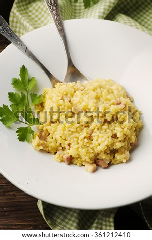 Italian traditional risotto with saffron and ham, selective focus