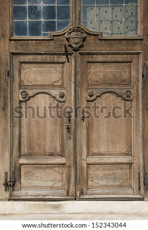 Italian typical architecture.  An old, rusty wooden door with lot of scratches  - stock photo