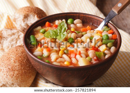Italian vegetable minestrone soup in a bowl close up. Horizontal  - stock photo