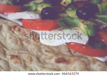 italian vegetable platter with pita bread (violet filtered shadows)