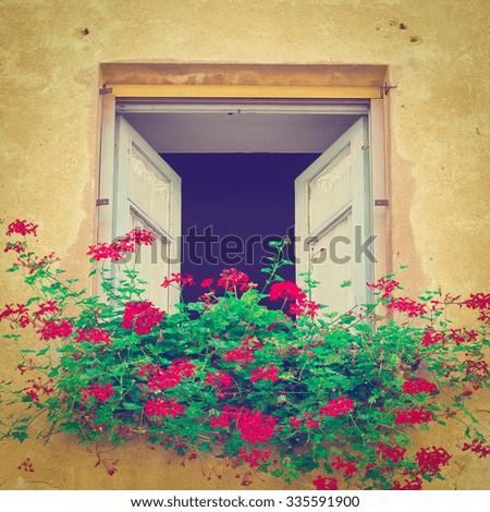 Italian Window Decorated with Fresh Flowers, Instagram Effect - stock photo