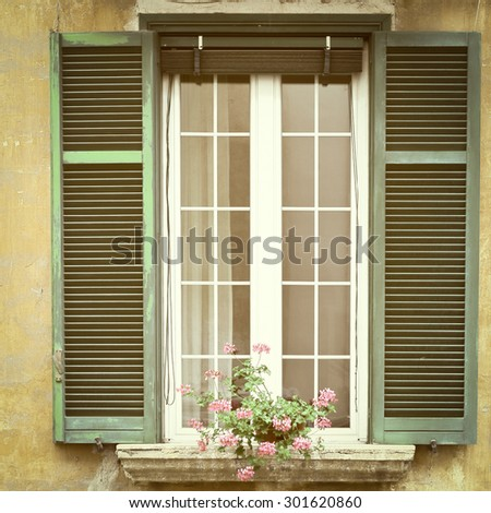 Italian Window with Open Wooden Shutters, Decorated With Fresh Flowers, Instagram Effect - stock photo