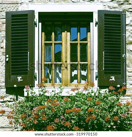 Italian Window with Open Wooden Shutters, Decorated With Fresh Flowers, Vintage Style Toned Picture - stock photo