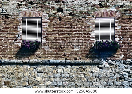 Italian Windows with Closed Shutters, Decorated with Fresh Flowers, Retro Image Filtered Style - stock photo