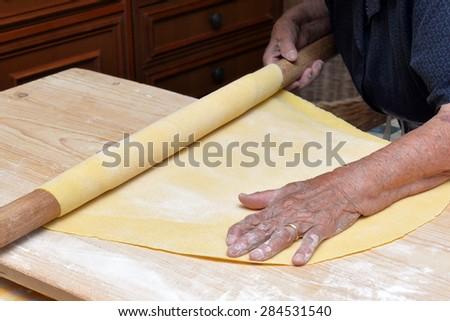 italian woman make homemade pasta for restaurant - stock photo