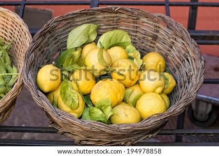 Italian yellow Lemons on display stand - stock photo