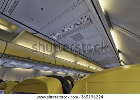 Italy, airplane cabin with no smoking sign on