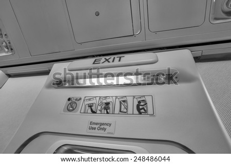Italy, airplane cabine, emergency exit light - stock photo