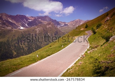 Italy Alps landscape, Stelvio National Park. Road to Gavia Pass in Ortler Alps. Filtered style colors. - stock photo