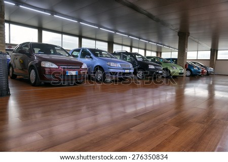 ITALY-APRIL, 2014: saloon cars sales in the European city; ITALY-APRIL, 2014 - stock photo