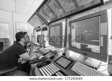Italy, Bari, International airport, flight control tower, flight controller working - stock photo