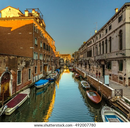 Italy beauty, parking boats in one of canal streets in Venezia , Venice