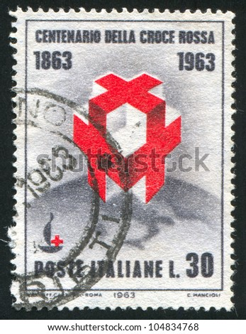 ITALY - CIRCA 1963: A stamp printed by Italy, shows Crosses and Centenary Emblem on Globe, circa 1963