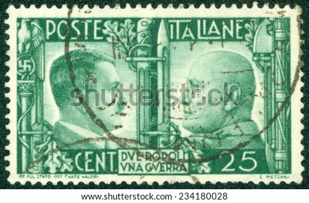 """ITALY - CIRCA 1941: A stamp printed by the fascist Italy Post is a portrait of Adolf Hitler and Benito Mussolini. It is entitled """"Due popoli una guerra"""" (Two nations one war), circa 1941 - stock photo"""