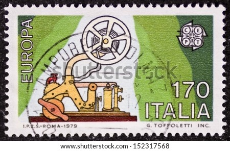 ITALY - CIRCA 1979: a stamp printed in Italy celebrates the European Idea showing an old telegraph machine. Italy, circa 1979 - stock photo