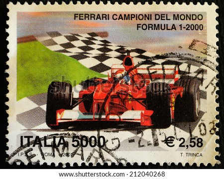 ITALY - CIRCA 2001: a stamp printed in Italy dedicated to Ferrari Formula 1 World Champions year 2000, circa 2001 - stock photo
