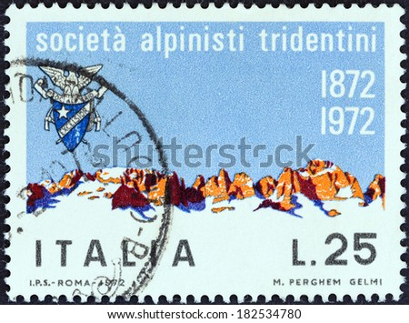 ITALY - CIRCA 1972: A stamp printed in Italy from the issued for the Centenary of Tridentine Alpinists Society shows Brenta Mountains, circa 1972. - stock photo