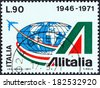 ITALY - CIRCA 1971: A stamp printed in Italy from the issued for the 25th anniversary of Alitalia State Airline shows emblem and globe, circa 1971. - stock