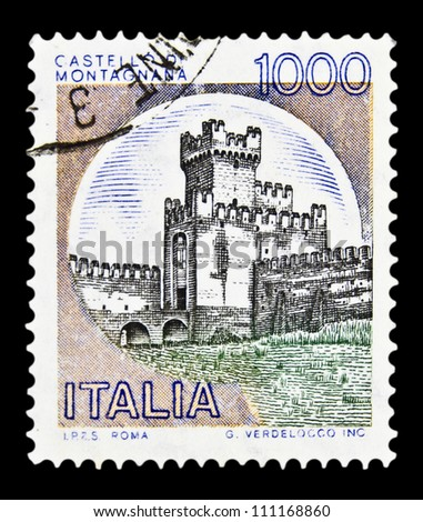 """ITALY - CIRCA 1980: A stamp printed in Italy, shows castle Montagnan with the same inscription, from the series """"Italian castles"""", circa 1980 - stock photo"""