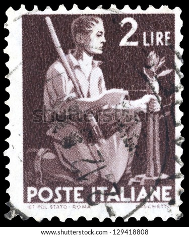 "ITALY - CIRCA 1945: A stamp printed in Italy shows Peasant grafting a tree, without inscription, from the series ""Democracy"", circa 1945 - stock photo"