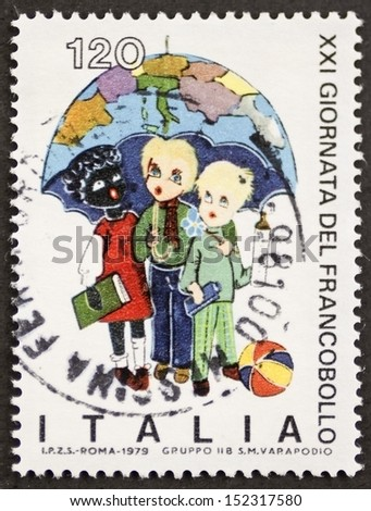 ITALY - CIRCA 1979: a stamp printed in Italy shows schoolboys and schoolgirl. Italy, circa 1979 - stock photo