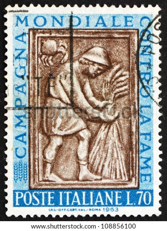 ITALY - CIRCA 1963: A stamp printed in the Italy shows Harvester Tying Sheaf, Sculpture from Maggiore Fountain, Perugia, Freedom for Hunger, circa 1963 - stock photo