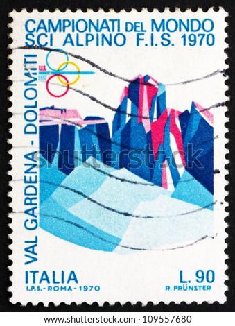 ITALY - CIRCA 1970: a stamp printed in the Italy shows Sassolungo and Sella Group, Dolomite Alps, World Alpine Ski Championships, Val Gardena, Bolzano Province, circa 1970 - stock photo