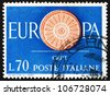 ITALY - CIRCA 1960: a stamp printed in the Italy shows 19-Spoke wheel, First Anniversary of the CEPT, 19 Founding Members of the Conference, European Integration, circa 1960 - stock photo