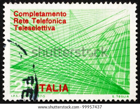 ITALY - CIRCA 1970: a stamp printed in the Italy shows Telephone Dial and Trunk Lines, Completion of the Automatic Trunk Telephone Dialing System, circa 1970